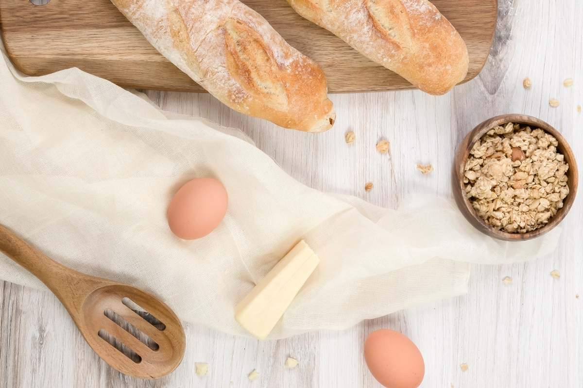 milk eggs and bread on counter