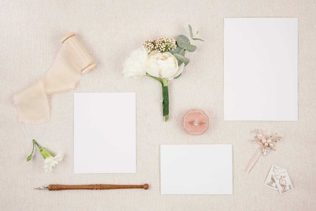 peach background with papers and ribbons