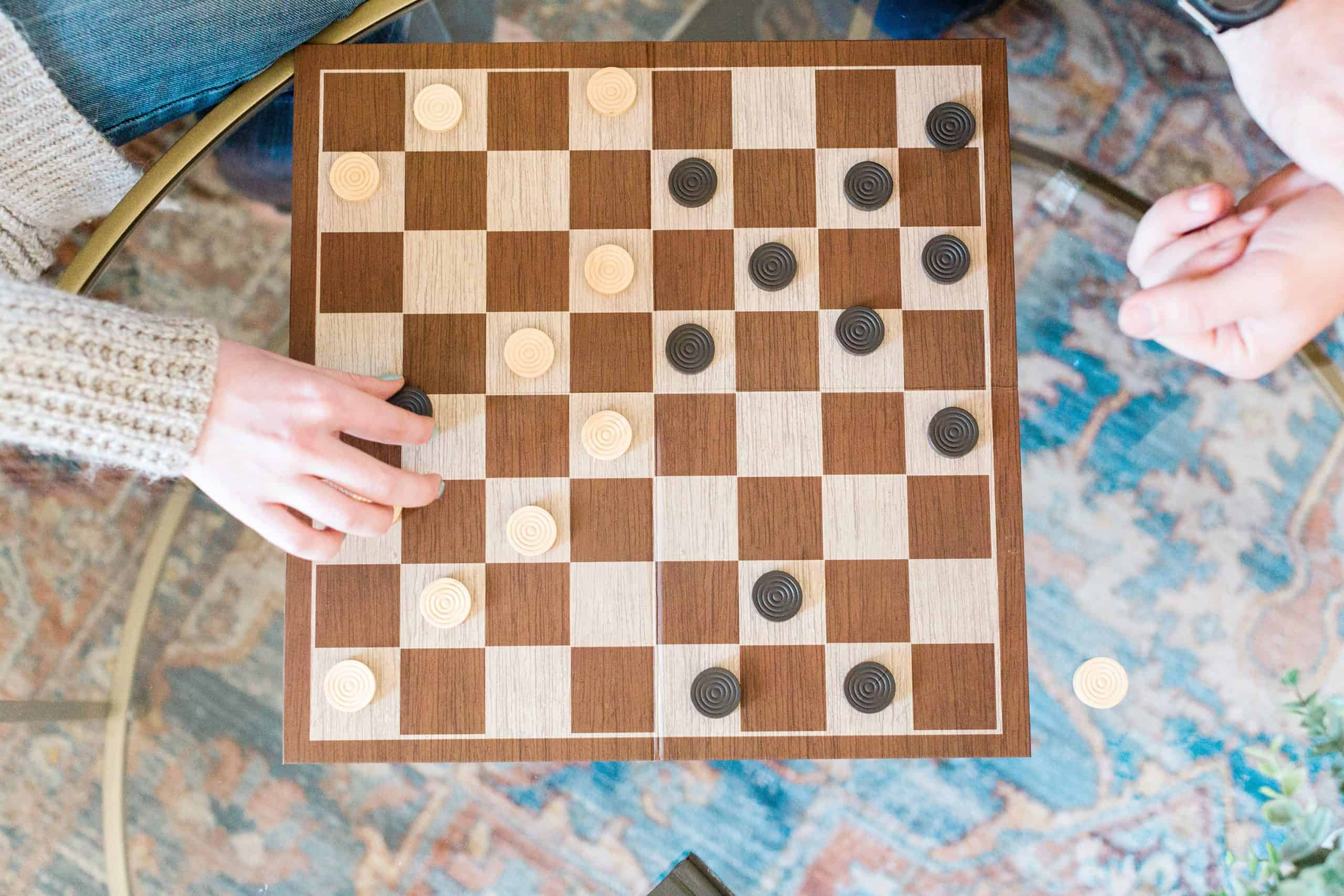 overhead view of couple playing chess