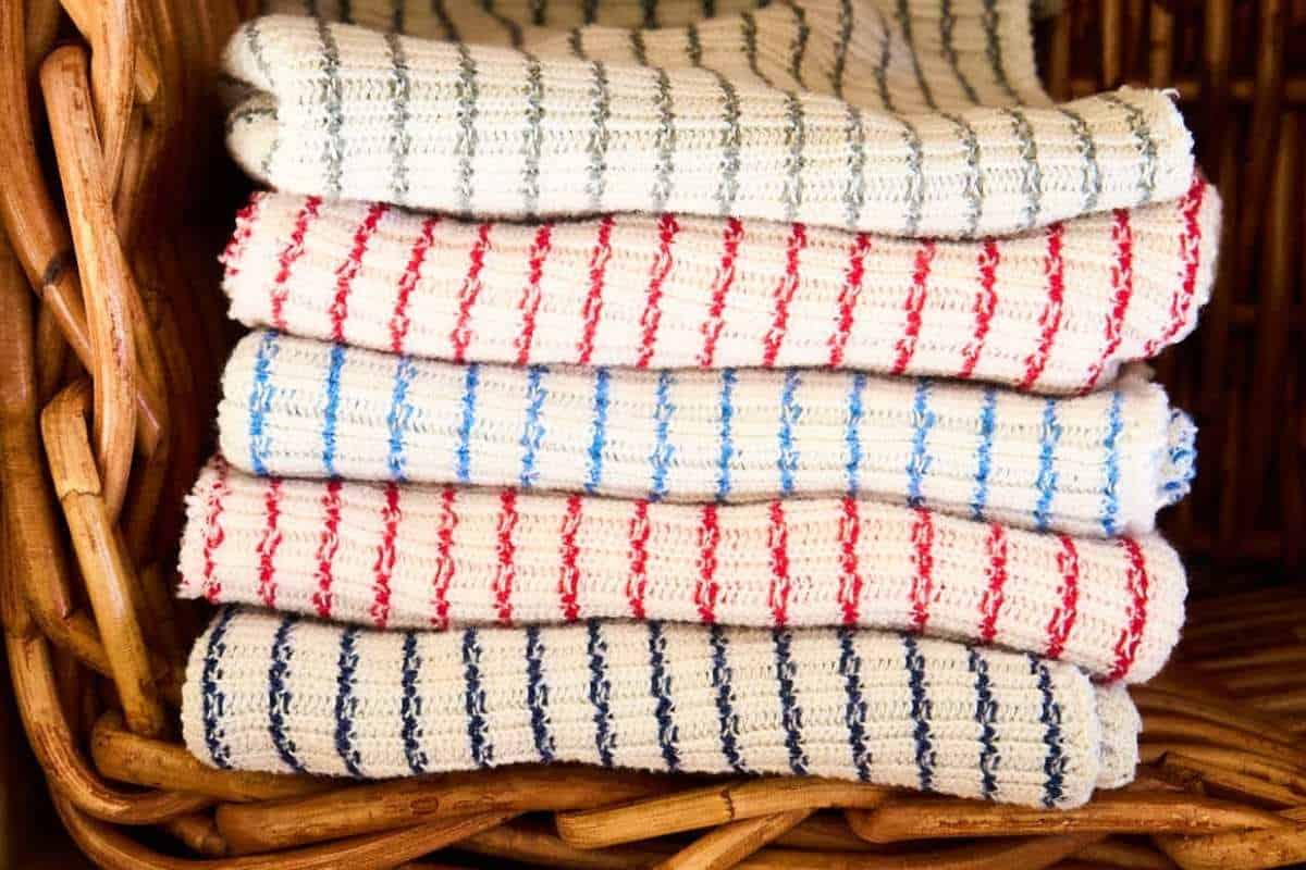 folded dish cloths in basket