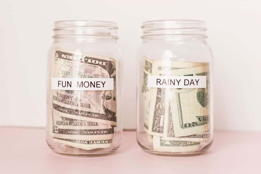 2 mason jars with cash