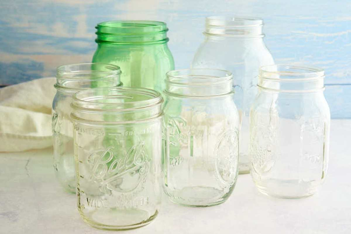 various sizes of mason jars in clear and green