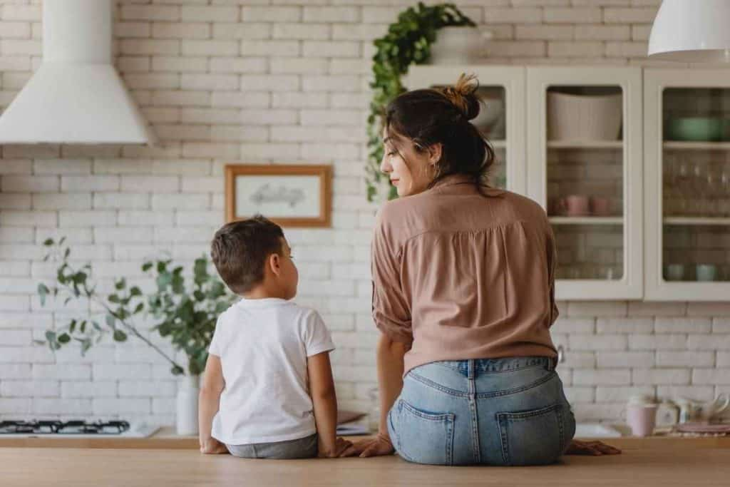 mom and kid sitting on counter