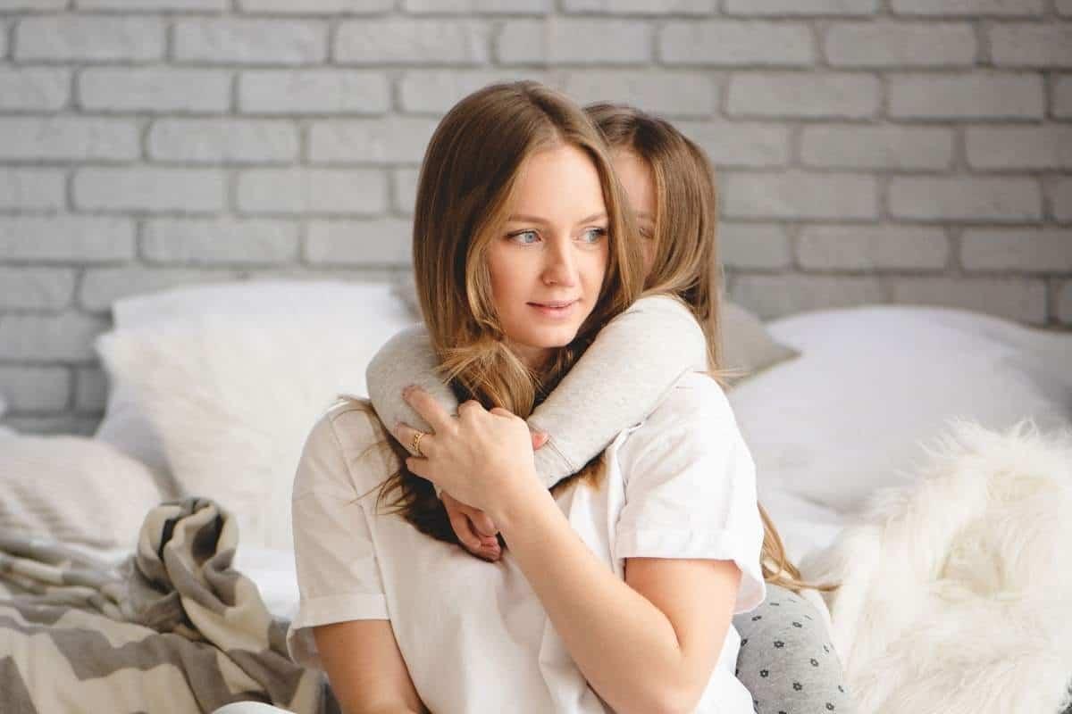 mom getting hugged by child