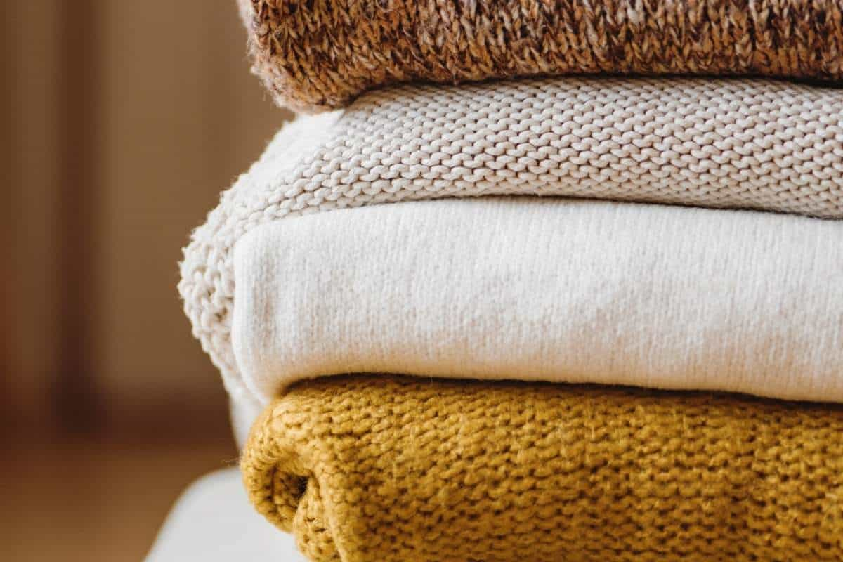 folded stack of brown and white sweaters