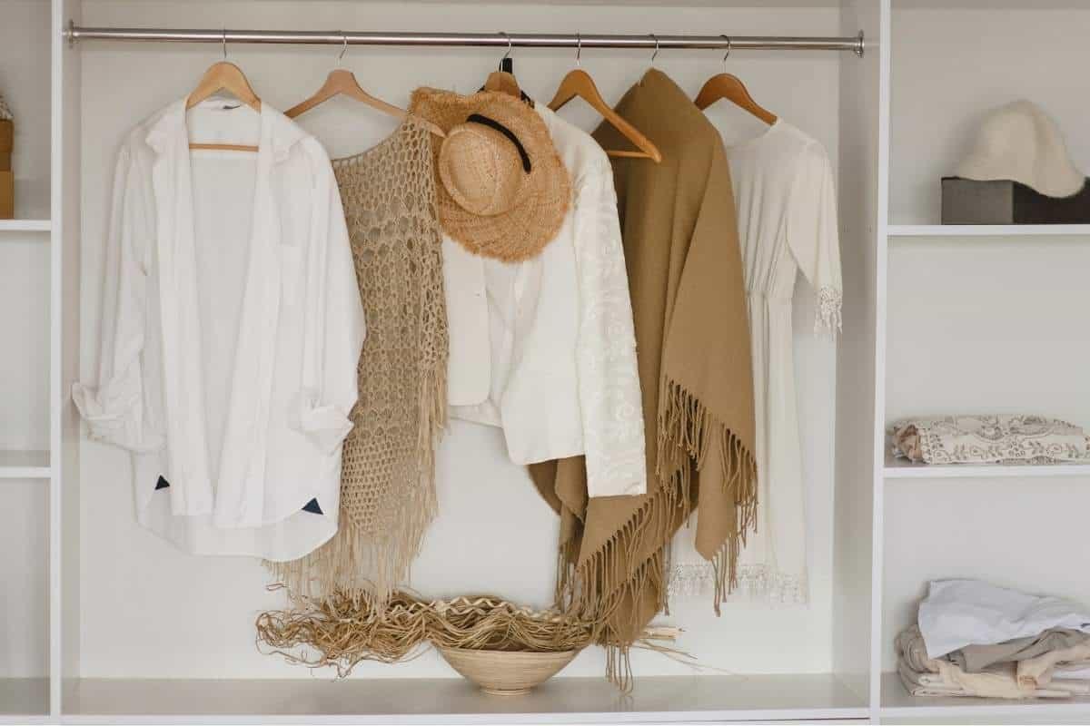 capsule wardrobe hanging in closeet