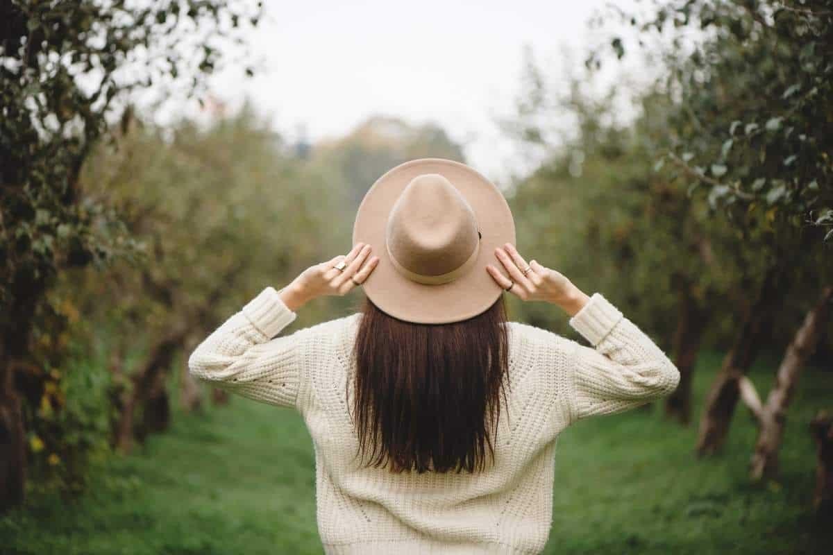 woman in hat facing away